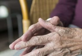 Old woman has shaking hands