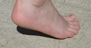 discomfort or swelling in the back of your heel.
